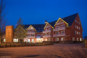 Aparthotel Strandhafer Warnemünde bei Nacht